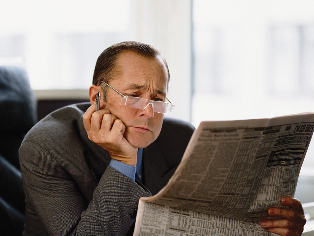 Businessman Reading Newspaper Financial Page